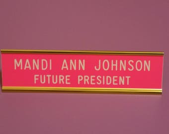 "Custom engraved 2"" x 8"" - Pink sign ~ white letters - gold anodized aluminum desk holder - designed for your Baby Girl or Toddler - 2 lines"