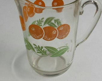 vintage glass pitcher with oranges/leaves