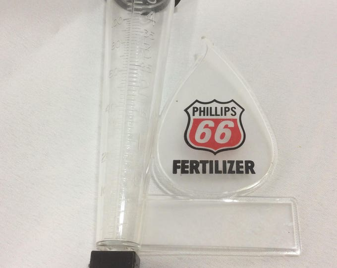 Vintage Phillips 66 rain gauge, Vintage advertisement for Phillips 66 fertilizer, vintage rain gauge, vintage Phillips 66 plastic rain gauge