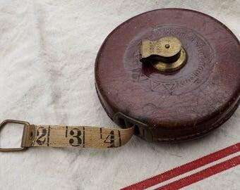 Vintage tape measure old school english measuring tape reel John Rabone & Sons Hockley Abbey 50ft measure workshop prop
