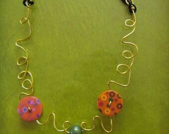 button necklace pink orange wire light