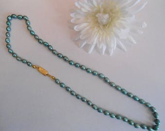 Light teal green knotted dyed cultured irregular pearls gold plated on rhodium necklace