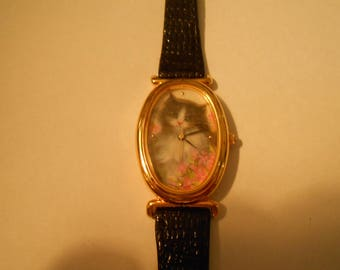 Beautiful avon cat watch