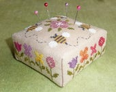 Flower Border Pincushion – counted cross stitch chart to work in own choice of colours. Square Pincushion. Flowers, Garden, Bees.