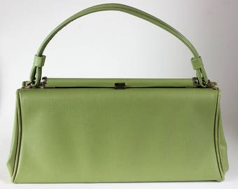 Elegant vintage light green barrel purse with push lock closure, from Classy USA