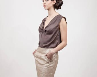 straight skirt is ruffled with overstitched pockets gold fabric