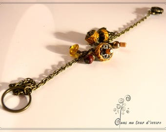 Textile bracelet mustard yellow and Brown bronze charm
