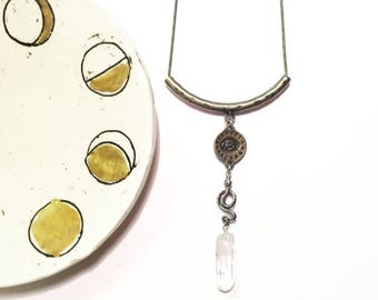 Snake Enchantress Necklace with Quartz Crystal and Brass Evil Eye