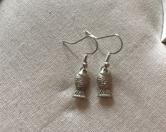 Tiny hanging flying fish silver coloured earrings end of line
