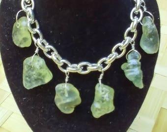 Bracelet of chunky bonfire seaglass on sterling silver.