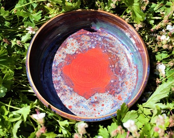 Red bowl with blue and green glaze