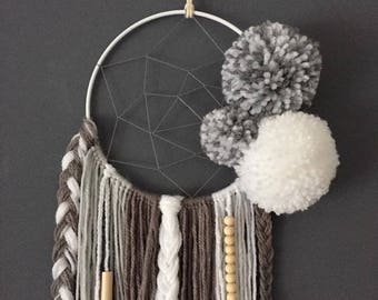 Dream catcher in gray and white and the tassels