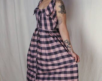 Vintage 1950s vixen! Black and pink large gingham with split back detail!