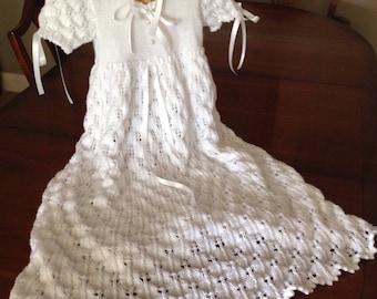 A stunning handknitted chritening gown and bonnet