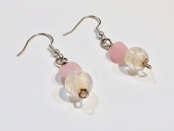 Handmade pink and translucent glass bead earrings with silver color metal ear wires