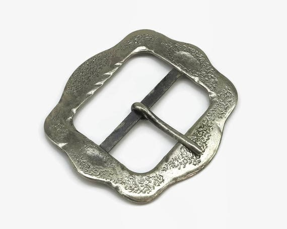 Large 1980's dark silver pressed metal buckle with tongue, decorative, almost square in shape