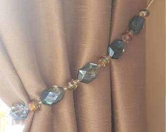 Beaded drapery tie-back with blue & jewel tone beads, on silver wire. Gorgeous and glam on blue, mauve or grey curtains!