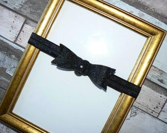 Glittery black felt bow baby headband