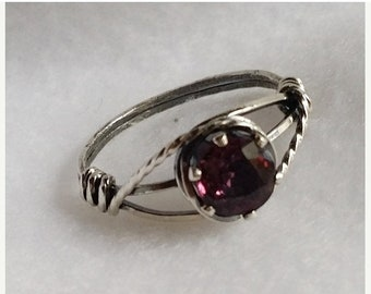 The perfect JANUARY BIRTHSTONE gift.  A natural deep pinkish purple, untreated stone with beautiful color in sterling silver.  Size 7
