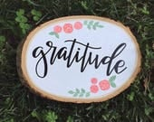 WORD of the YEAR   wood slice   hand painted wood slice   new year's resolution   grace abide gratitude rooted