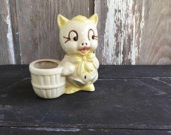 1950s vintage Shawnee pottery yellow pig planter