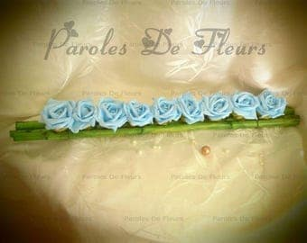 Centerpiece of 9 turquoise roses and bamboo
