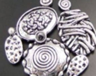 Large round pendant abstract embossed silver-plated 40x32mm
