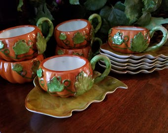 Pumpkin shaped cup with leaf saucer, porcelain, hand painted