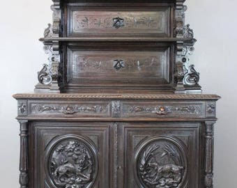 French Carved Hunt Cabinet