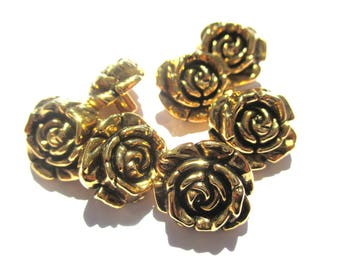 A BUTTON TAIL FLOWER PINK GOLD BLACK GOLD 15 MM HEIGHT 7 MM DIAMETER ROUND