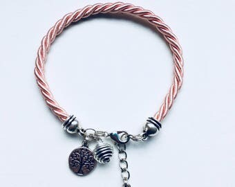Pink bracelet with tree of life pendant