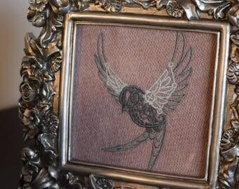 Steampunk bird, embroidered in metallic look floral frame.