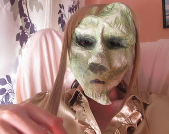 Mask paper mache. Zombie woman. Asymmetric.