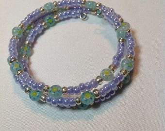 Lavender silver memory wire bracelet with Milfori flowers in blue and yellow
