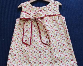 girls dress size 2T or 2,  %100 cotton with matching headband, 2 piece set