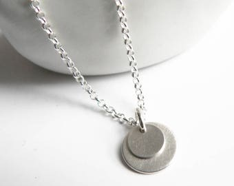 Necklace with silver round pendant disc