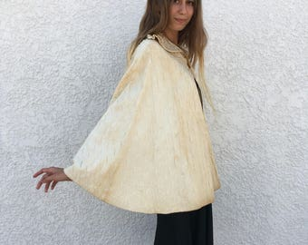 1934 Quilted Cream Cape with Yellow Button