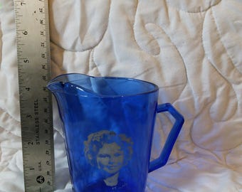 Shirley Temple, Sapphire blue or Cobalt blue, milk pitcher, creamer, chipped, Captain January costume, Hazel Atlas Glass Co produced 1936-42