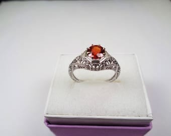 Red Garnet Ring in 14kt. White Gold Ring. 94 Point, 5.5mm Natural Round Garnet in White Gold with Dimond Accents.