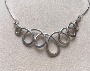 Argentium silver loop necklace.