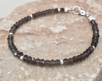 Gray bracelet made with smokey quartz rondelles beads, Hill Tribe silver rolled and rondelle beads with a sterling trigger clasp
