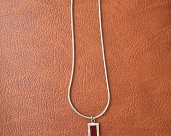 Silver rectangular pendant with serpentine chain