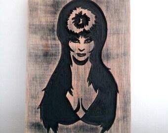 Elvira, mistress of the dark carving