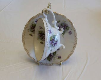 vintage ew japan 3 footed teacup & saucer set w/ purple violet flowers - ew-2/734A hand painted antique porcelain fine china tea cup art