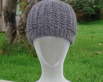 Lace patterned handknitted hat.