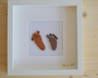 Beach pebble feet framed art