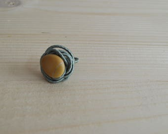 Silk statement ring with yellow pebble gem
