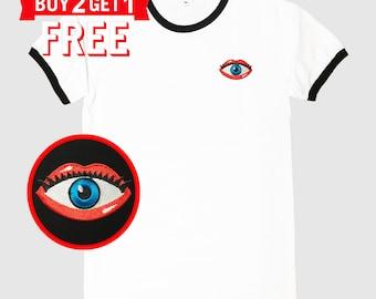 Eye in Lips Embroidered Ringer T-Shirt by 24PlanetsStudio