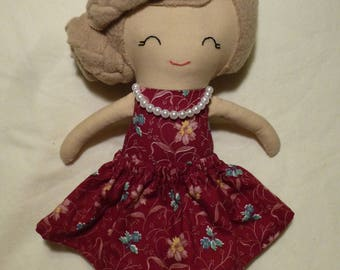 Cloth/Rag doll with light brown hair, pearl necklace, burgandy dress