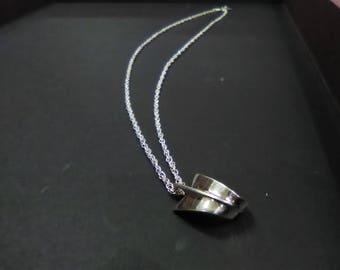 Tiffanys Chain Necklace with Wavy Ribbon Pendant